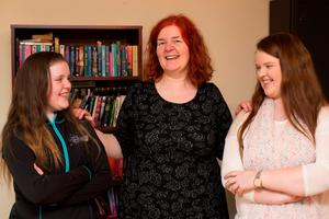 Stuck in the middle with you: Eileen Gormley with her daughters Eris (14) and  Brianna (18). Photo:Mark Condren
