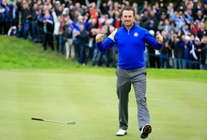 Europe's Graeme McDowell celebrates wining his singles match. Harry How/Getty Images
