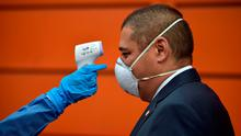 Part of the procedure: Temperature checks at airports will be another hassle in the future. Photo: RAUL ARBOLEDA/AFP via Getty Images