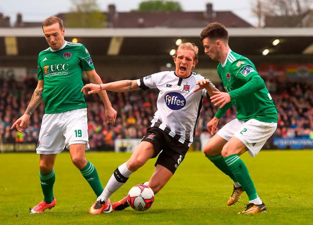 Dundalk's John Mountney is tackled by Cork City's Karl Sheppard and Jimmy Keohane. Photo: Eóin Noonan/Sportsfile