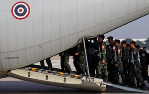 Thai Armed Forces medical team walk to a C-130 cargo plane at the military airport in Bangkok, Thailand, April 28, 2015. The Royal Thai Armed Forces sent 67 medical and rescue personnel to assist the earthquake victims in Nepal, according to The Royal Thai Armed Forces authorities.   REUTERS/Chaiwat Subprasom