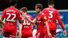 Fulham's Harry Arter (right) celebrates scoring his side's first goal of the game with Cyrus Christie during the Sky Bet Championship match at Loftus Road, London.