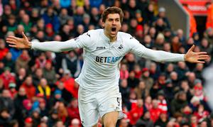 Fernando Llorente celebrates scoring the first of his two goals against Liverpool. Photo: Ed Sykes/Reuters
