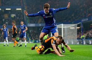 Chelsea's Marcos Alonso in action with Hull City's David Meyler. Photo:  Reuters / Eddie Keogh