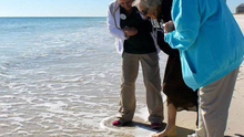 Ruby Holt, from Tennessee, was taken to the beach by her care home just before her 101st birthday.