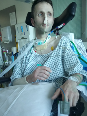 Rob Lambert recovering in hospital after the crash last April.