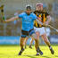 Dublin captain Danny Sutcliffe battles for possession with Kilkenny's Ciaran Wallace during the Cats' victory on Sunday. Photo: Ray McManus/Sportsfile