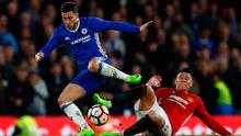 Chelsea's Eden Hazard in action with Manchester United's Marcos Rojo