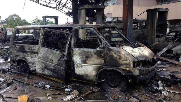 The charred wreckage of a minivan is seen at a gas station that exploded overnight killing around 90 people in Accra, Ghana, June 4, 2015. REUTERS/Matthew Mpoke Bigg