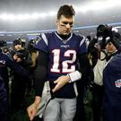 New England Patriots quarterback Tom Brady (12) walks off of the field after a loss to the Tennessee Titans at Gillette Stadium. Mandatory Credit: Greg M. Cooper-USA TODAY Sports