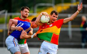 Sean Gannon, right, and Ciaran Moran of Carlow in action against Michael Quinn of Longford. Photo: Ramsey Cardy/Sportsfile