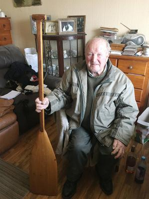 Michael Manning (81) is pictured at his home with a wooden boat paddle that was used by his assailant to strike him over the head. Photograph Press 22