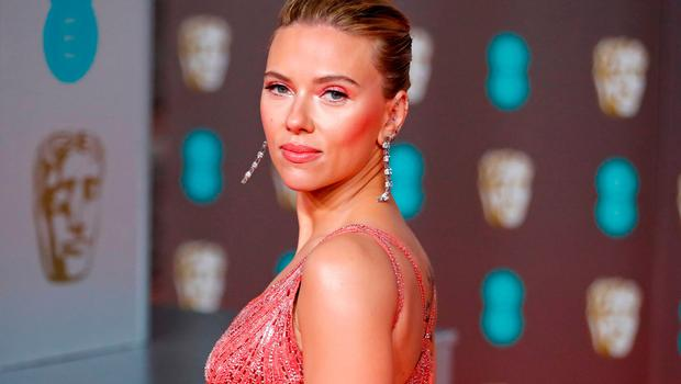 US actress Scarlett Johansson poses on the red carpet upon arrival at the BAFTA British Academy Film Awards at the Royal Albert Hall in London on February 2, 2020. (Photo by Tolga AKMEN / AFP)
