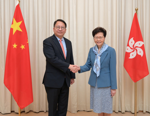 Hong Kong chief executive Carrie Lam with Eric Chan. Photo: via Reuters