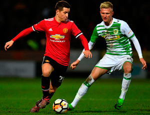 Manchester United's Ander Herrera keeps the ball from Yeovil Town's Sam Surridge. Photo: Getty Images