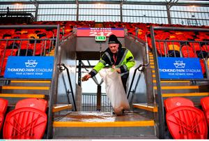 21 January 2018; Match steward Gerry Kennedy spreads sand onto the walkways of the West Stand prior to the European Rugby Champions Cup Pool 4 Round 6 match between Munster and Castres at Thomond Park in Limerick. Photo by Diarmuid Greene/Sportsfile