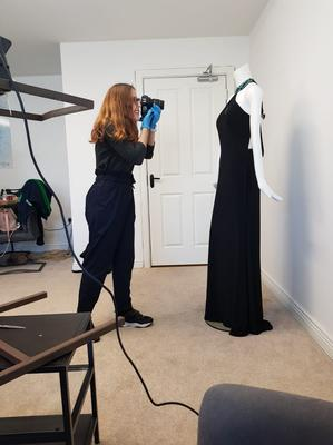 Response: Sara Henriques from Thriftify taking photos of garments donated to NCBI which are now being sold online after its 117 charity shops had to close