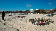 File photo dated 03/07/15 of flowers on the beach near the RIU Imperial Marhaba hotel in Sousse, Tunisia, as the massacre of 38 tourists on the Tunisian beach is being linked to an earlier terror attack in the country which killed 22 people, Scotland Yard said today. Steve Parsons/PA Wire