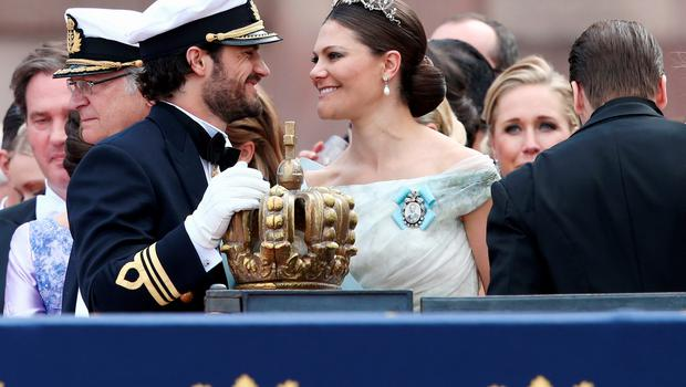 STOCKHOLM, SWEDEN - JUNE 13:  Prince Carl Philip of Sweden places one hand on the crown as he chats with his sister, Crown Princess Victoria of Sweden, after his marriage ceremony to Princess Sofia, at The Royal Palace on June 13, 2015 in Stockholm, Sweden. In 1980, Sweden became the first monarchy to change its succession rites so that the first-born child of the monarch is heir to the throne, regardless of gender.  (Photo by Andreas Rentz/Getty Images)