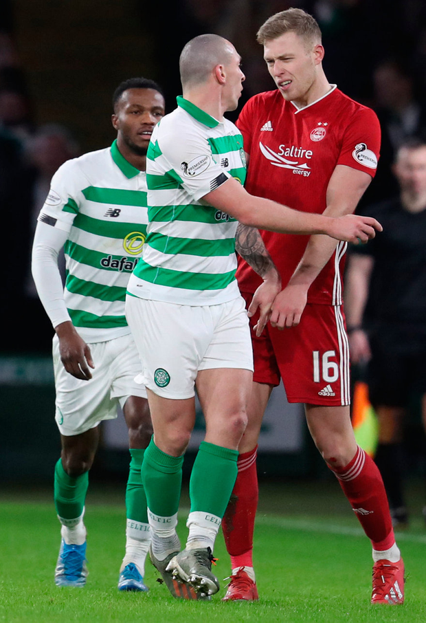 Aberdeen's Sam Cosgrove clashes with Celtic's Scott Brown after being sent off. Photo: PA