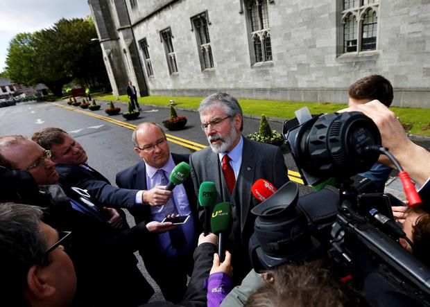 Sinn Fein president Gerry Adams (R) speaks with members of the media as he arrives at the National University of Ireland in Galway, Ireland May 19, 2015. Britain's Prince Charles is to meet Gerry Adams in Ireland on Tuesday, the first time the leader of the former political wing of the Irish Republican Army (IRA) has met a senior member of the royal family, his Sinn Fein party said.   REUTERS/Darren Staples