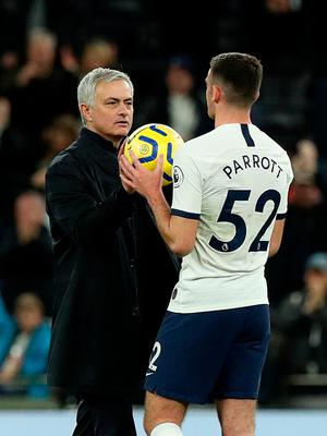 Jose Mourinho hands the ball to Troy Parrott after Tottenham's victory. Photo: Jonathan Brady/PA Wire