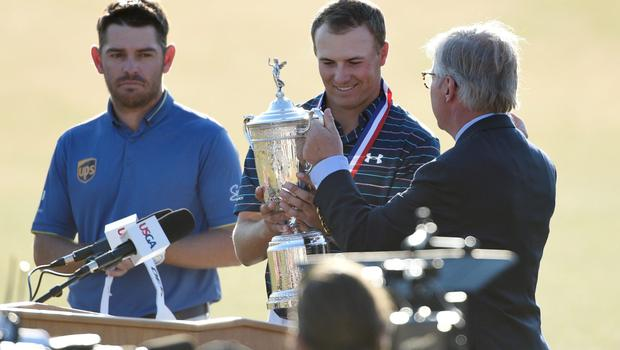 Jun 21, 2015; University Place, WA, USA; Jordan Spieth (middle) is presented with the U.S. Open Championship Trophy while standing next to Louis Oosthuizen (left) after the final round of the 2015 U.S. Open golf tournament at Chambers Bay. Mandatory Credit: Kyle Terada-USA TODAY Sports