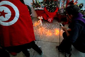 Women set up candles during a demonstration in front of the National Bardo Museum a day after gunmen attacked the museum and killed scores of people in Tunis, Tunisia. Photo: AP