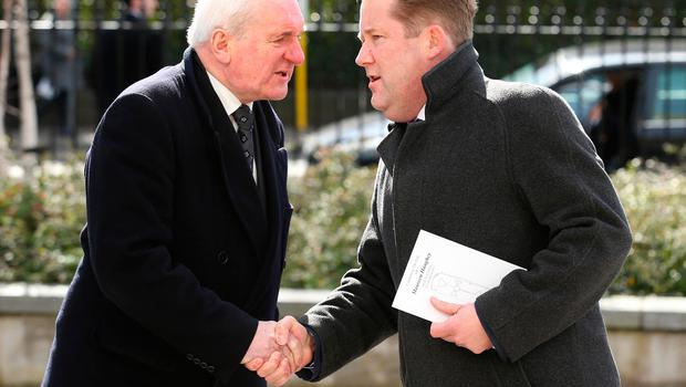 Former Taoiseach, Bertie Ahern shakes hands with Darragh O'Brien, TD outside St. Sylvester's Parish Church, Malahide before the funeral of Maureen Haughey. Credit: Damien Eagers