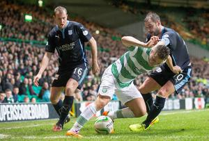 Celtic's James Forrest is closed down by David Clarkson (left) and Gary Harkins (right). Photo credit: Jeff Holmes/PA Wire