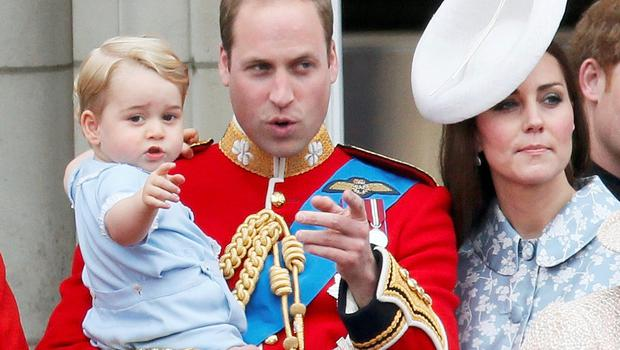 Britain's Prince Willian holds Prince George as he waves with Catherine, the Duchess of Cambridge on the balcony at Buckingham Palace after attending the Trooping the Colour ceremony at Horse Guards Parade in central London, Britain June 13, 2015. Trooping the Colour is a ceremony to honour the Queen's official birthday.    REUTERS/Stefan Wermuth