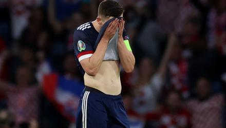 Scotland's Andrew Robertson looks dejected after Croatia's Ivan Perisic scored their third goal