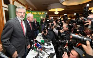 Sinn Fein President Gerry Adams arrives at a news conference in Belfast after he was released from police detention
