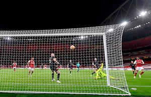 Joe Willock puts Arsenal's second goal past Dundalk keeper Gary Rogers at the Emirates last night. Photo: Getty Images