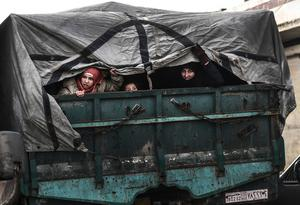 Seeking safety: Civilians flee from Idlib toward the north to find safety inside Syria near the border with Turkey. Photo: AP Photo