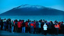 A evening prayer vigil held for the familes and crew of Rescue 116 with Blackrock Lighthouse in the distance near Blacksod Co Mayo. Credit: Steve Humphreys
