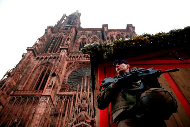 A soldier guards the Christmas market in Strasbourg. Photo: Reuters