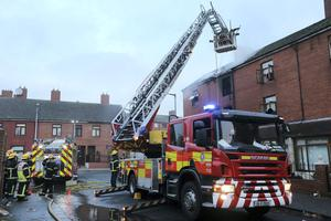 Firefighters in a hoist pictured at the scene of The Gloucester Place Fire this morning.