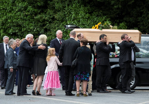 The remains of Lorcan Miller are brought to Rathmichael parish church for his funeral mass this morning. Photo: Mark Condren