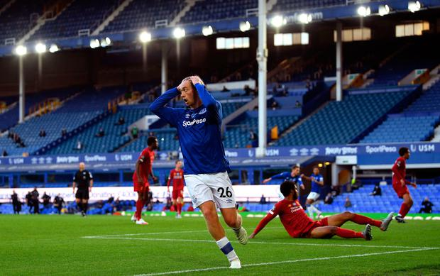 SO CLOSE: Tom Davies reacts after hitting the post late on against Liverpool. Pic: Shaun Botterill/PA Wire/NMC Pool.