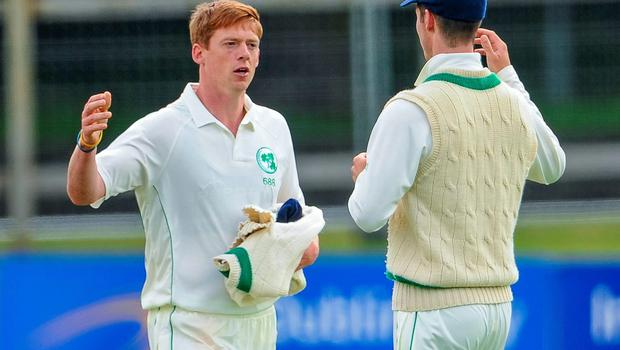 Craig Young (left) congratulates his Ireland teammate George Dockrell taking the catch to clinch victory in their InterContinental Cup clash with the United Arab Emirates at Malahide. Photo: Seb Daly / SPORTSFILE