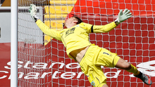 Nick Pope dives to deny Liverpool yet again during Burnley's draw at Anfield, which ended the champions' chance of a 100 per cent home record this season. Photo: PA