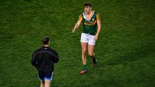 Kerry captain David Clifford offers a handshake to Philly McMahon of Dublin