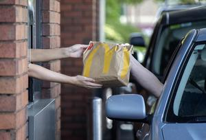 20/05/2020 Staff serve people on the first day of re-opening at the McDonald's Drive thru on the Kylemore Road, Dublin. Picture Colin Keegan, Collins Dublin