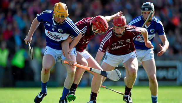 Niall Healy and Cathal Mannion, right, Galway, in action against Brian Stapleton, Laois