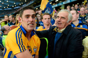Brendan Bugler, Clare, is congratulated by his father Seamus following his side's victory in 2013