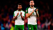 Cyrus Christie (L) and Shane Duffy salute the visiting fans in Cardiff on Thursday. Photo by Stephen McCarthy/Sportsfile