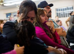 Family members Ana Maria Patino (L), Delia Patino (C), and Rafael Patino (R), become emotional while watching U.S. President Barack Obama's national address in Phoenix. Obama imposed the most sweeping immigration reform in a generation on Thursday, easing the threat of deportation for about 4.7 million undocumented immigrants and setting up a clash with Republicans. But the reforms do little to change John's situation (REUTERS/Deanna Dent )