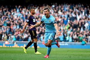 Manchester City's Sergio Aguero celebrates scoring their second goal of the game during the Barclays Premier League match at the Etihad Stadium, Manchester. PRESS ASSOCIATION Photo. Picture date: Sunday April 19, 2015. See PA story SOCCER Man City. Photo credit should read: Martin Rickett/PA Wire. RESTRICTIONS: Editorial use only. Maximum 45 images during a match. No video emulation or promotion as 'live'. No use in games, competitions, merchandise, betting or single club/player services. No use with unofficial audio, video, data, fixtures or club/league logos.