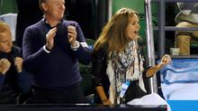 Kim Sears (R), fiancee of Andy Murray of Britain, celebrates after he defeated Tomas Berdych of Czech Republic in their men's singles semi-final match at the Australian Open